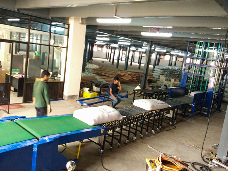Bangladesh Tea Factory-flexible powered roller conveyor