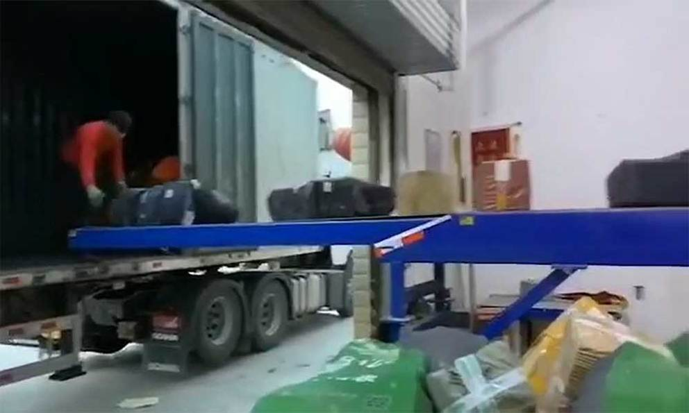 Courier company loading cartons parcels into trucks